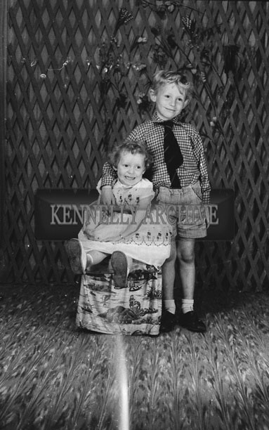 1953; A Studio Photo Of A Brother And Sister.