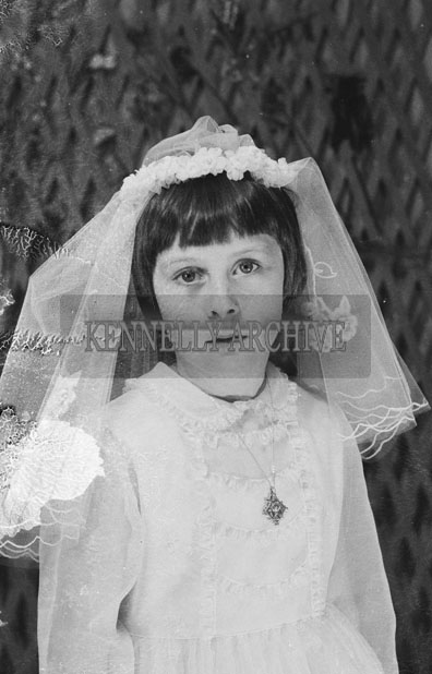 1953; A Studio Photo Of A Communion Girl.