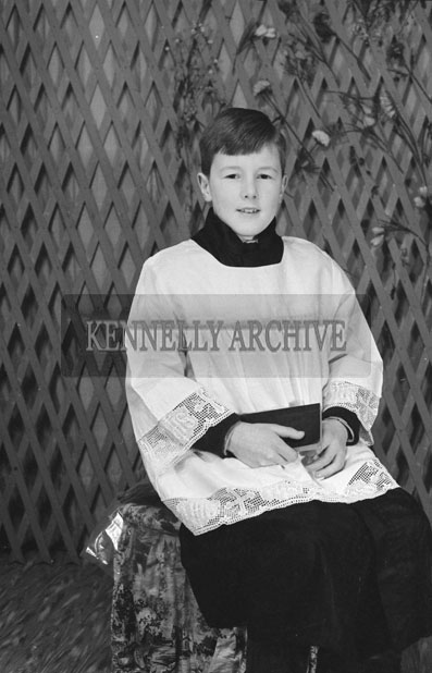 1953; A Studio Photo Of An Altar Boy.