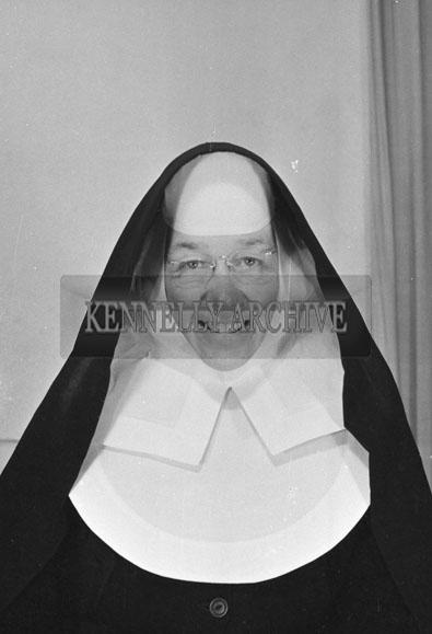 1953; A Studio Photo Of A Nun.