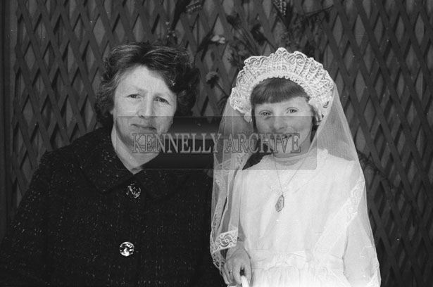 1953; A Studio Photo Of A Communion Girl With A Member Of Her Family.