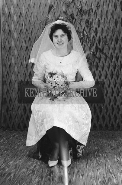 1953; A Studio Photo Of A Bride Posing For The Camera.