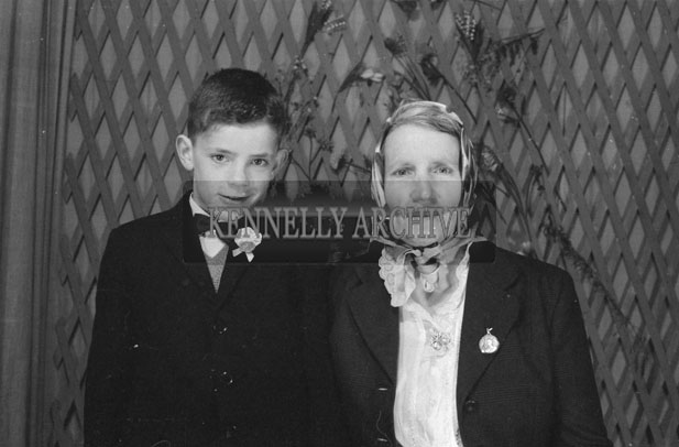 1953; A Studio Photo Of A Communion Boy With His Mother.