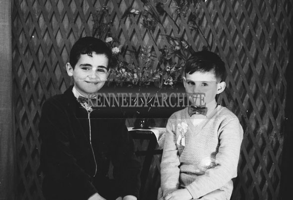 1953; A Studio Photo Of A Communion Boy Posing For The Camera With His Brother.