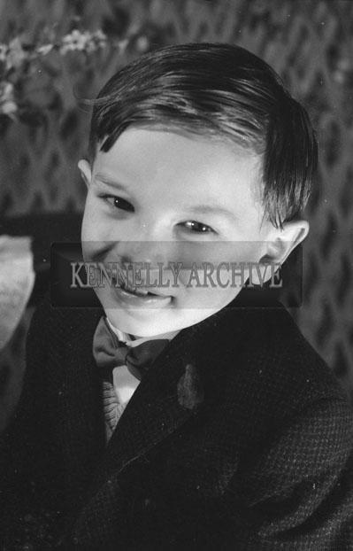 1953; A Studio Photo Of A Boy