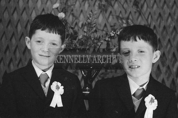 1953; A Studio Photo Of Two Communion Boys.