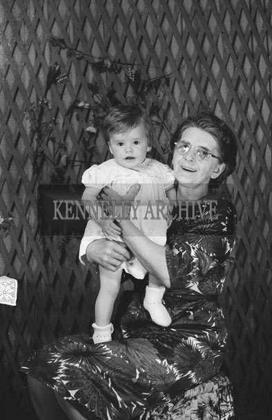 1953; A Studio Photo Of A Woman Holding A Baby Girl.