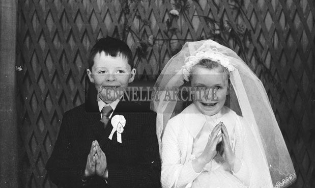 1953; A Studio Photo Of A Communion Boy And Girl.