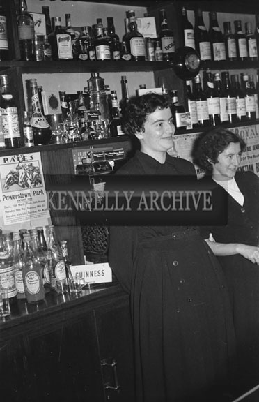 13th February 1954; Two women behind the bar in Benners Hotel at the Social and Economic Science graduation dinner.