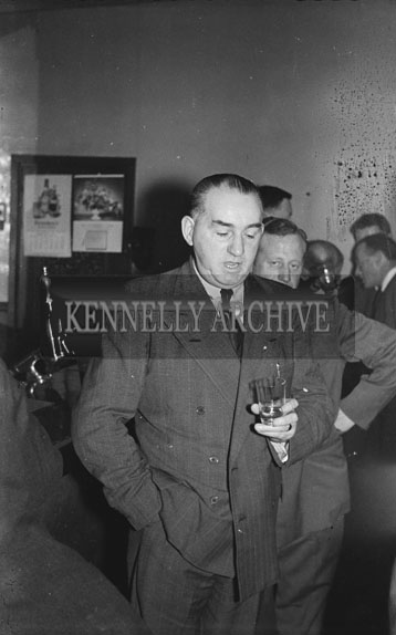 13th February 1954; A man in the bar in Benners Hotel at the Social and Economic Science graduation dinner.
