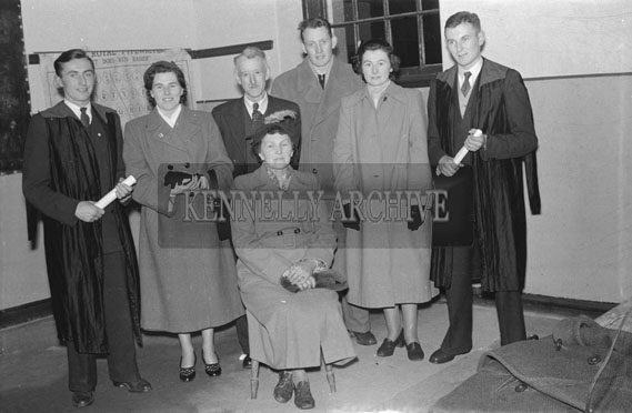 13th February 1954; Social and Economic Science graduates pose for a photo with family in the Central Technical School in Tralee.
