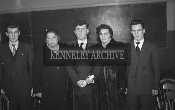 13th February 1954; A Social and Economic Science graduate poses for a photo with his family in the Central Technical School in Tralee.