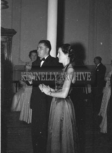 January 1954; A Couple Clapping At The Golf Dress Dance And Dinner In Killarney.