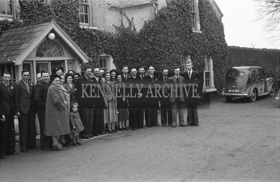January 1954; The wedding party posing at the Carroll wedding reception outside the Meadowlands Hotel in Tralee.