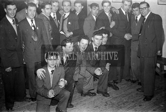 February 1954; A Group Of Men Posing At The Kerins O'Rahillys Social At The Meadowlands Hotel, Tralee. Included in the photo at the far right hand corner is John Kissane (Club Secretary) shaking the hand of John Dowling. The social was held to celebrate the club's 1953 Senior County Championship win against Shannon Rangers. The final was held on the 20th September 1953 in Austin Stack Park, where the Strand Road team defeated Shannon Rangers 1-4 to 0-5.