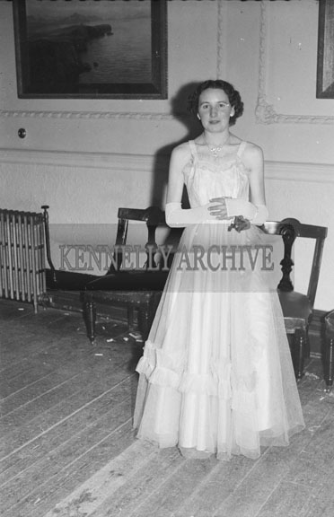 February 1954; A woman poses for the camera at the TCLS dance at the Killarney Lake Hotel.