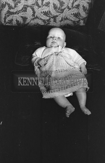 February 1954; A baby at home.