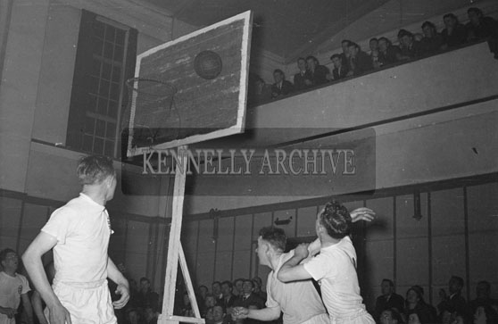 April 1954; An Action Shot At A Basketball Match At The CYMS Tralee.