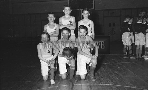 April 1954; A Young Team Posing For The Camera At A Basketball Match At The CYMS Tralee.