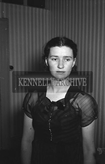 April 1954; A Studio Photo Of A Woman.