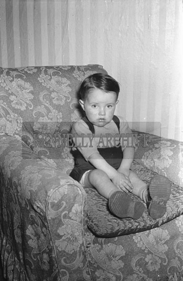 April 1954; A Studio Photo Of A Little Boy.