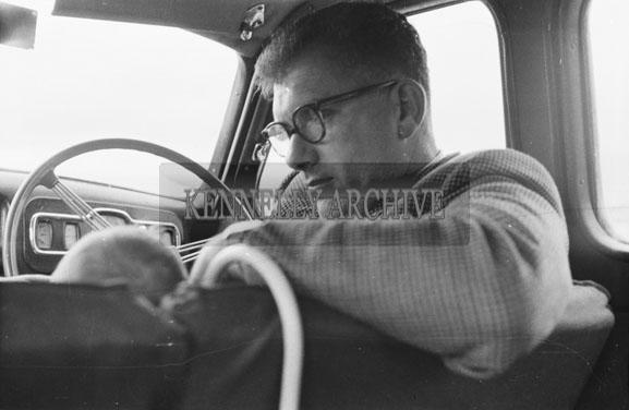June 1954; A Man Posing In A Car.