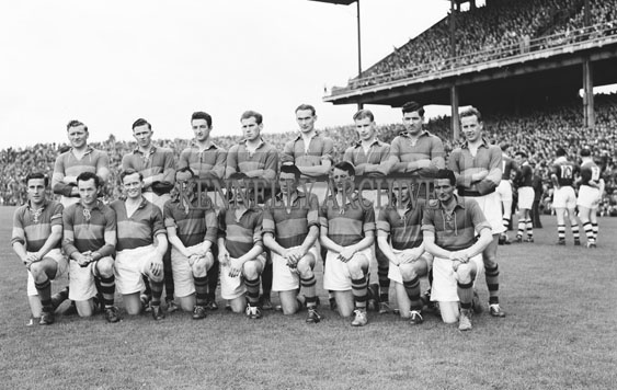 15th August 1954; The Kerry Team Posing For The Camera At The All-Ireland Semi-Final Between Kerry And Galway At Croke Park. Kerry Beat Galway 2-6 To 1-6. Back row from left: Jackie Lyne, Tadhgie Lyne, John Joe Sheehan, Donie Murphy, Tom Moriarty, Stack, John Cronin, Colm Kennelly. Front: Garry O'Mahony, Diarmuid Dillon, Bobby Buckley, Sean Kelly, Jim Brosnan, John Dowling (capt.), Sean Murphy, Paudie Sheehy, James 'Micksie' Palmer.