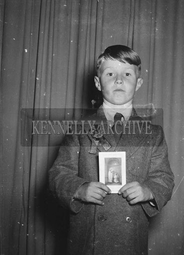 May 1954; A Studio Photo Of A Communion Boy.