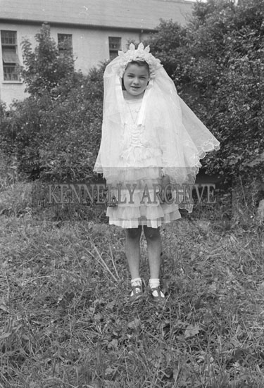 20th June 1954; A First Communion Girl Of The Corpus Christi Procession In Tralee Posing For The Camera.