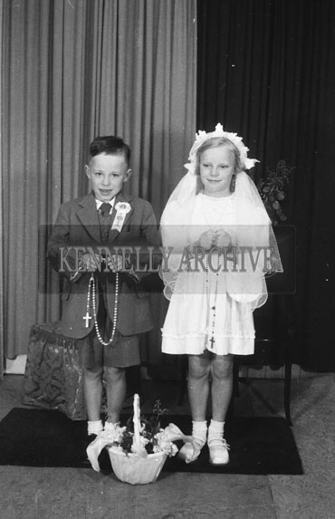 June 1954; A Studio Photo Of A Communion Boy And Girl.