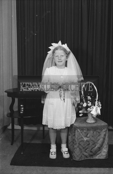 June 1954; A Studio Photo Of A Communion Girl.