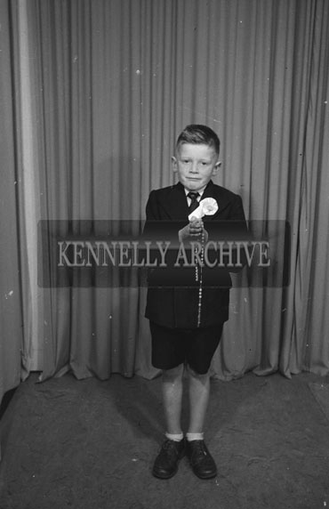 July 1954; A Studio Photo Of A Communion Boy.
