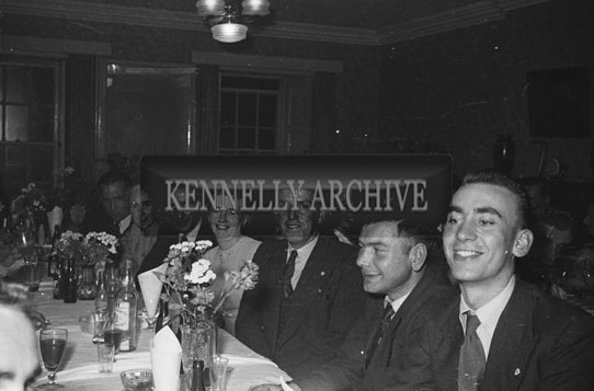 August 1954; A Group Of People Posing For The Camera At Their Tables At The Post Office Presentation And Social In The Meadowlands Hotel, Tralee.