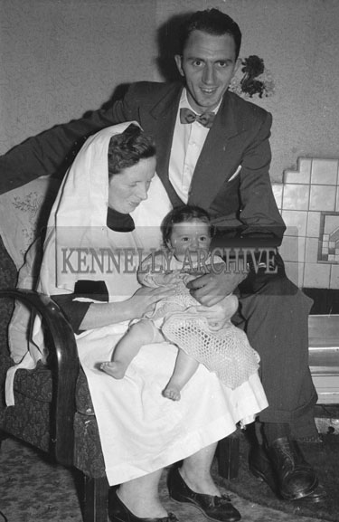 August 1954; Padraig Kennelly Senior With A Nun Holding The McAulliffe Baby Of Dublin.