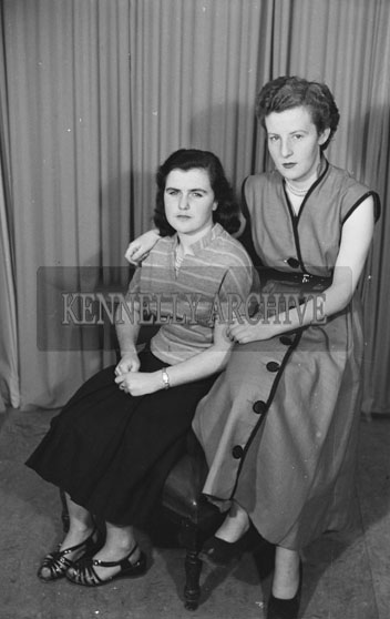 August 1954; A Studio Photo Of Two Women.
