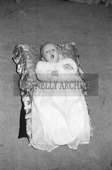 September 1954; A Studio Photo Of A Baby.