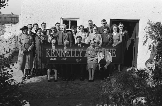 September 1954; A Wedding Party Pose At A Wedding Outside A House In Tralee.