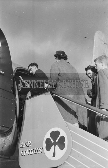 October 1954; The Wedding Party Of The Michael And Joan Glazier Wedding Boarding A Plane In Dublin Airport.