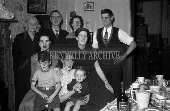 November 1954; A Family Posing At A Child's First Birthday Party At Home.