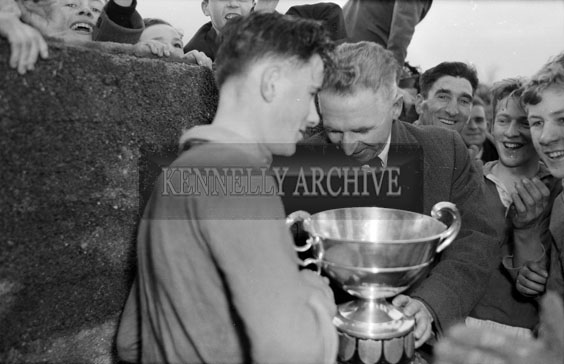 28th November 1954; The Tralee CBS Captain Receiving The Trophy At The O'Sullivan Cup Final Against St Brendan's Killarney. Tralee CBS Won 4-2 To 0-0 At Austin Stack Park In Tralee.