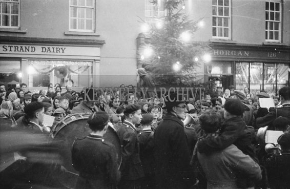 December 1953; Celebrations In Tralee As The Christmas Tree Is Being Lit At Horgans (The Brogue Inn). Santa Also Pays A Visit.