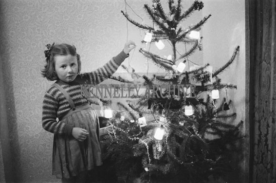 December 1953; The Young Fitzmaurice Child With The Christmas Tree At Home.