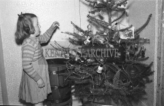 December 1953; Young Fitzmaurice Child With The Christmas Tree At Home.