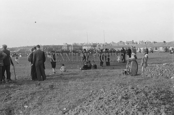 December 1954; A Small Crowd Watching A Football Game At Strand Road G.A.A. Pitch In Tralee.