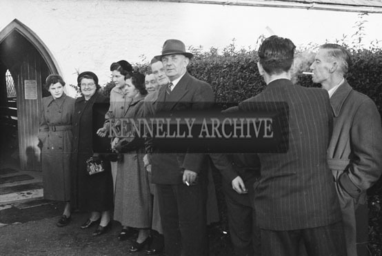 1954; The Wedding Party Waiting For The Newlyweds At Miss Hurley's Wedding Of Strand Street, Tralee At St Catherine's Church, Tralee.