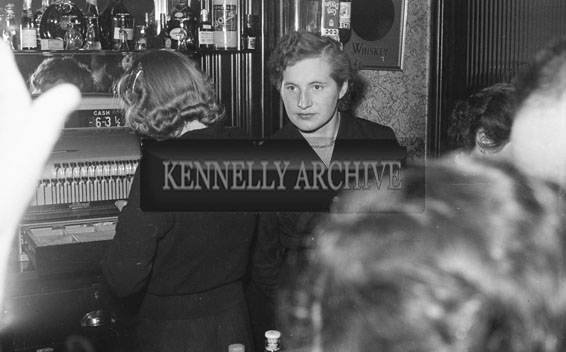 8th December 1954; Two Women Behind The Bar At The Tralee Tennis Dance Held At The Lake Hotel In Killarney.