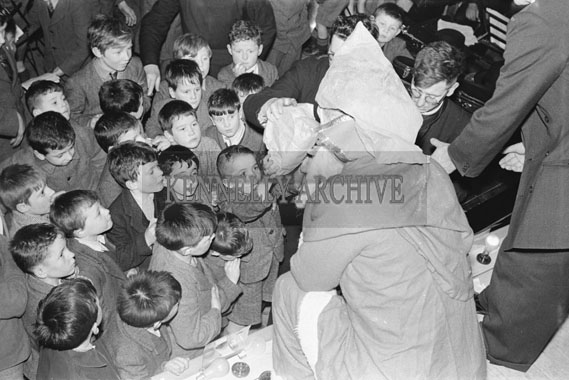 25th December 1954; Santa Visits St Joseph's School, Tralee, To Hand Out Presents During Their Christmas Concert.