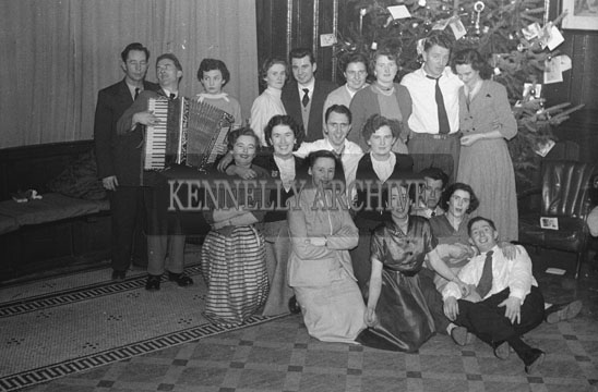 25th December 1954; Members Of The Kennelly Family Celebrate Christmas Day At Castle Street, Tralee. Padraig Kennelly Senior is at the centre of the photo.