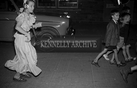 7th September 1956; Young people in costume enjoying the night at the Tralee Fancy Dress Parade.