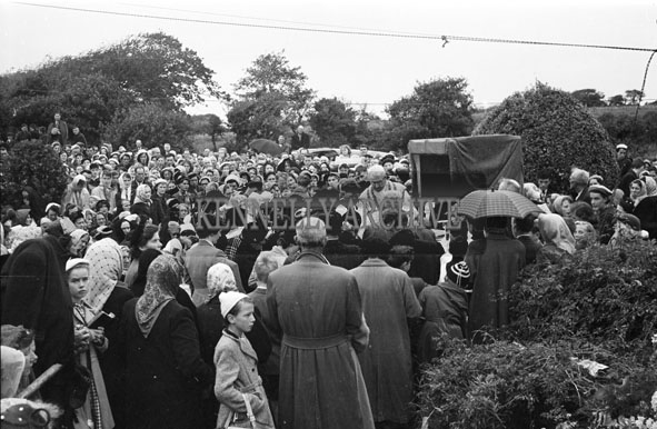8th September 1956; A crowd gathered for an open air mass which took place on Pattern Day in Ballyheigue.